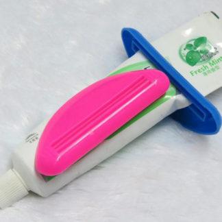 Klämma för tandkräm eller andra tuber